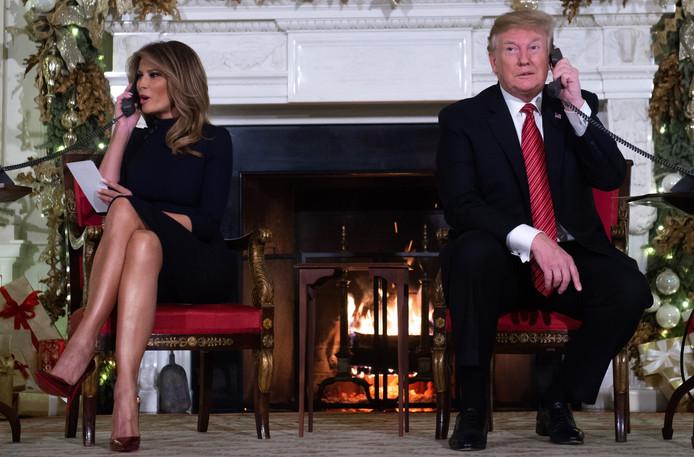 Donald Trump and First Lady Melania Trump bellen met kinderen op kerstavond.