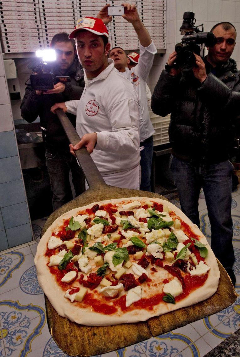 Een traditionele Napolitaanse pizza. Beeld epa