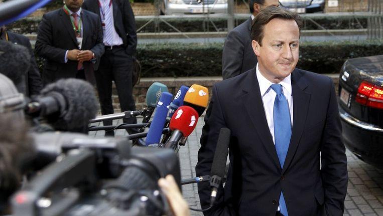 De Britse premier David Cameron arriveert bij de Europese top in Brussel. Beeld reuters