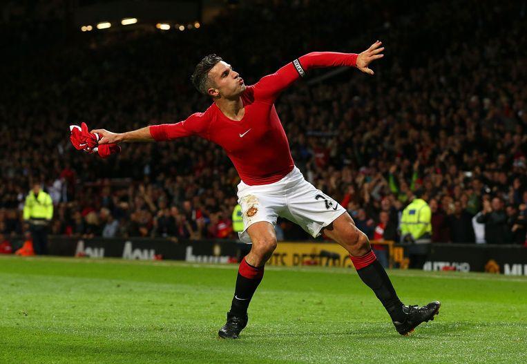 Robin van Persie viert zijn late gelijkmaker voor Manchester United. Beeld getty