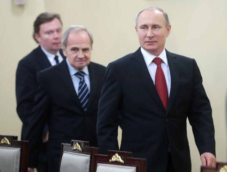 President Poetin (rechts) met de voorzitter van het Constitutioneel Hof Valery Zorkin. Beeld HH