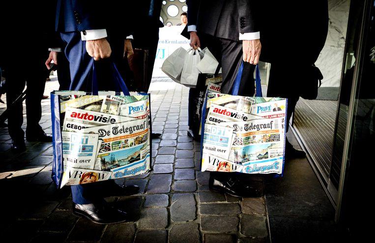 De directeuren Geert-Jan van der Snoek en Leo Epskamp hadden TMG-tassen meegenomen naar de Ondernemingskamer. foto remko de waal, anp Beeld ANP