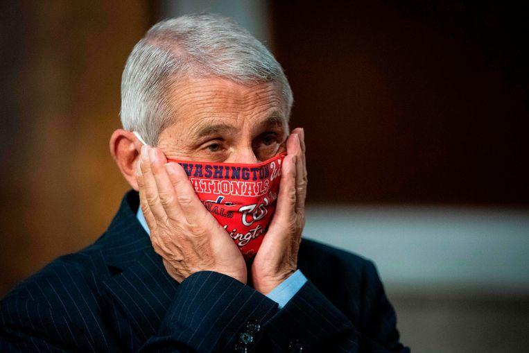 Een mondkapje hoort erbij, vindt Fauci, en zo verscheen hij dus vorige maand in de Senaat.   Beeld AFP