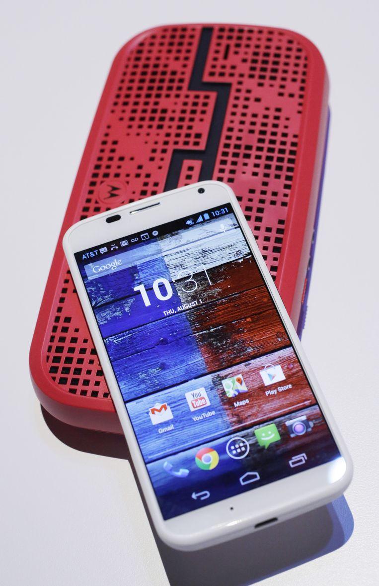 Het bekendste voorbeeld van apparaten die draaien op bluetooth: de smartphone. Beeld AP