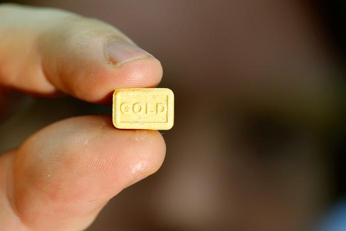 Een xtc-pil in de vorm van een gold bar.
