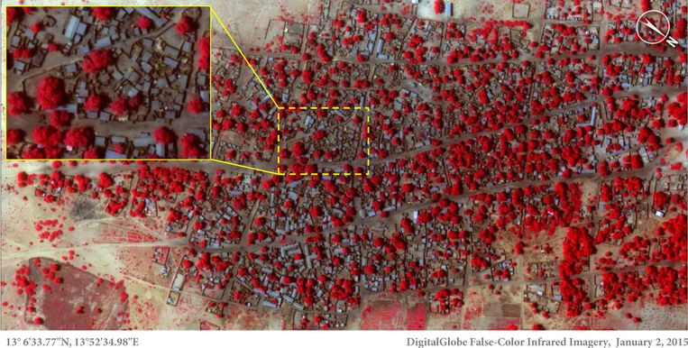 Satelietfoto van het dorp Doron. Dit is een beeld van 2 januari. Bomen en struikgewas zijn in rood aangegeven, de huizen blauwgrijs. Beeld ap
