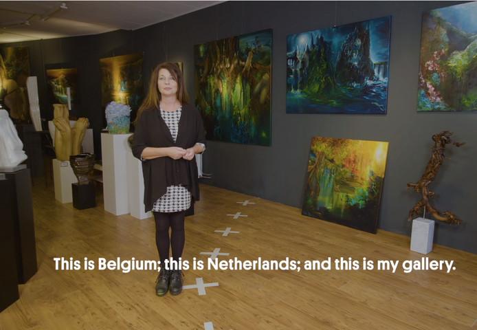 Sylvia Reijbroek in haar galerie. De grens loopt er recht doorheen.