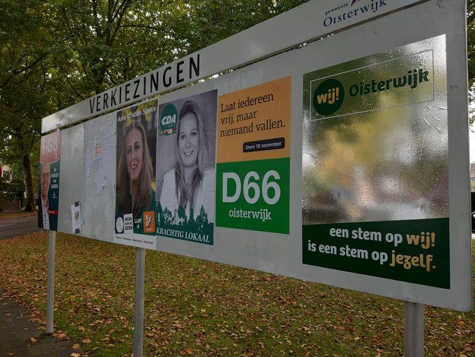 De verkiezingsborden in Oisterwijk zijn al aardig vol. Nieuwkomer WIJ! Oisterwijk heeft een verkiezingsposter als spiegel.