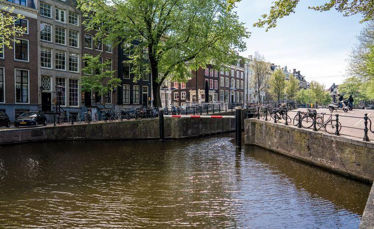 Een lege Herengracht in Amsterdam Amsterdam tijdens Koningsdag dit jaar. Beeld Freek van den Bergh / de Volkskrant