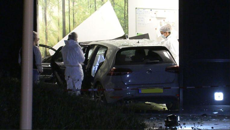 Onderzoek naar de gecrashte auto van Kelvin Maynard. Beeld INTER VISUAL STUDIO via REUTERS