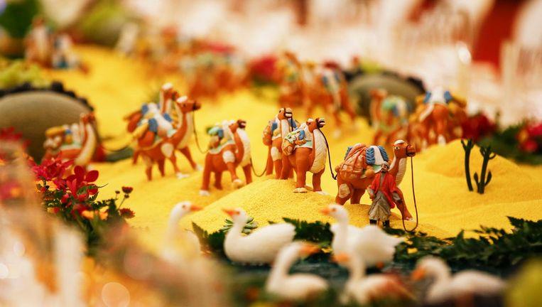 Een sculptuur van voedsel tijdens het banket op het Belt and Road Forum symboliseert de oude Zijderoute. Beeld getty