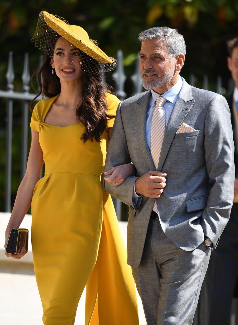 George Clooney en zijn vrouw Amal op het huwelijk van Meghan en Harry.