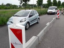 Geen rotonde of extra stoplicht op druk kruispunt