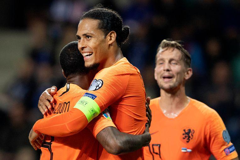 Georginio Wijnaldum scoorde de 4-0 en wordt gefeliciteerd door Virgil van Dijk. Beeld ANP