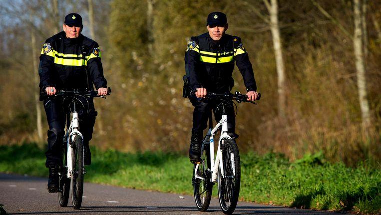 Agenten op de fiets. Beeld ANP