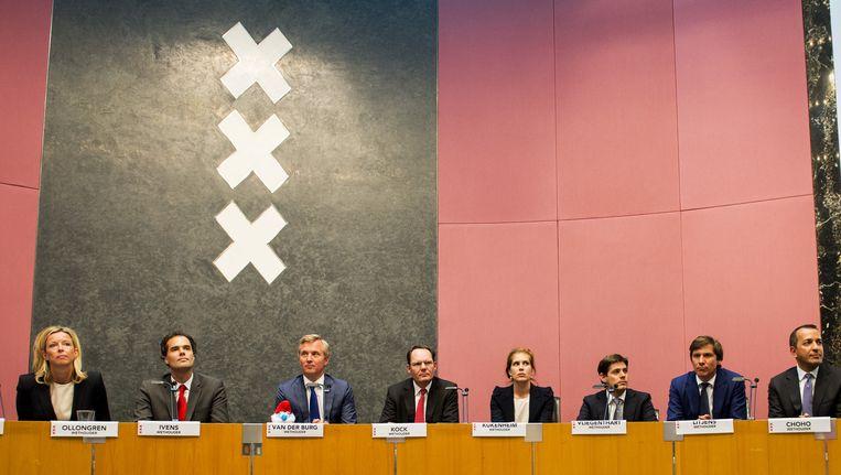 De nieuwe wethouders bij hun installatie in Amsterdam Beeld anp