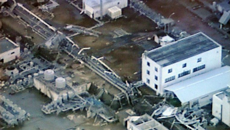 Beeld van de deels ontplofte reactorgebouwen. Beeld afp