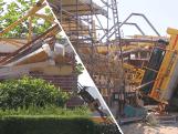 Hoge bouwkraan valt om: kind aan de dood ontsnapt