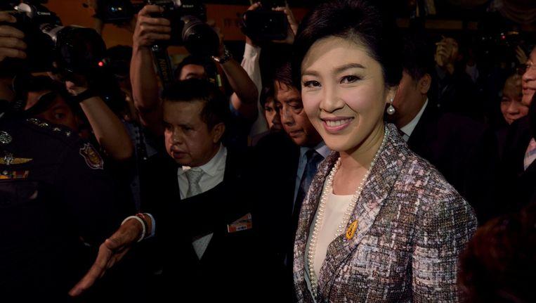 De Thaise premier Yingluck gisteren bij het parlement in Bangkok. Vandaag werd ze uit haar ambt gezet. Beeld afp