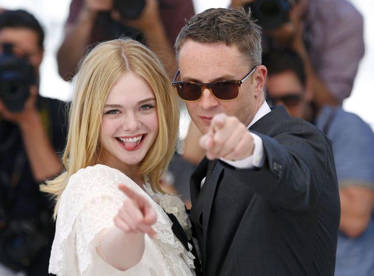 Nicolas Winding Refn (R) met actrice Elle Fanning. Beeld reuters
