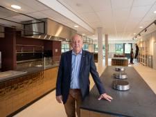 Werklui zijn druk om de nieuwbouw van Vakschool Wageningen op tijd gereed te hebben