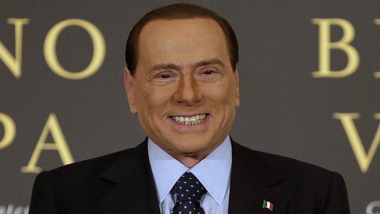 Silvio Berlusconi tijdens een boekpresentatie. Beeld reuters