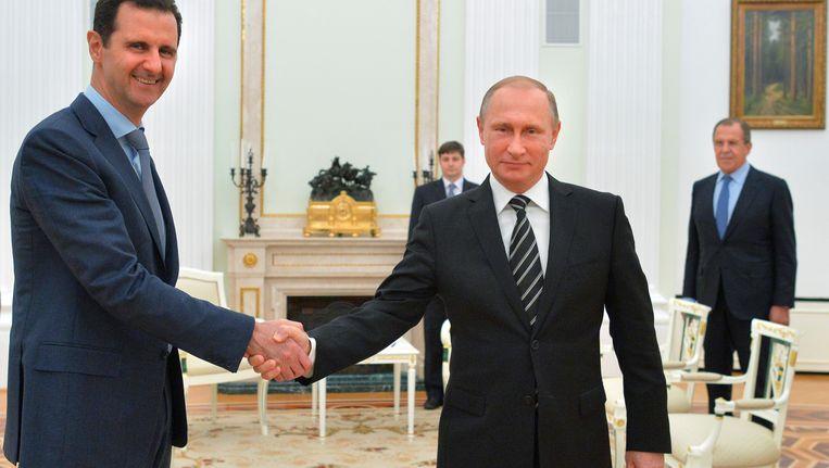 Archieffoto van oktober 2015: de Russische president Poetin ontmoet de Syrische president Assad Beeld AP