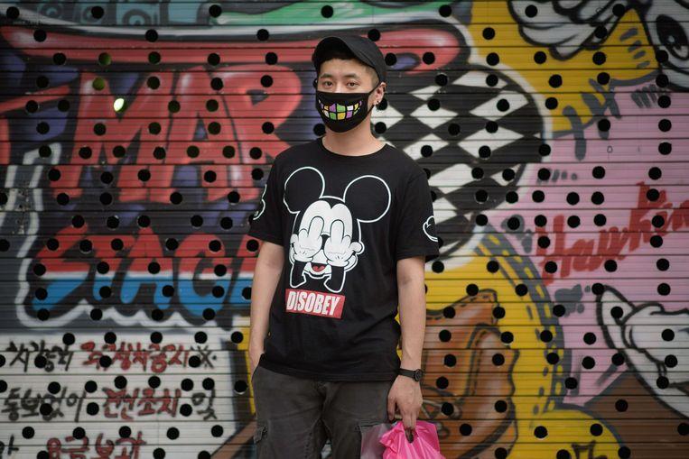Een jongen in Seoul met een mondkapje. Beeld afp