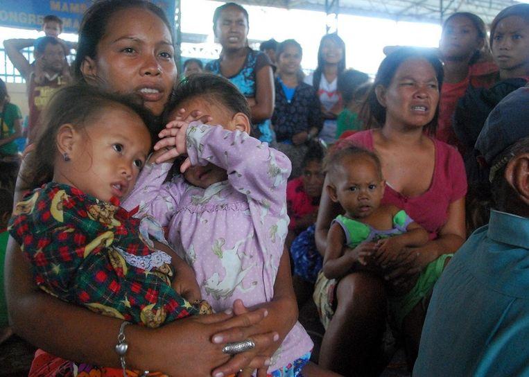 Filipijnse families die opvang hebben gevonden in Cebu. Beeld epa