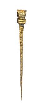 Messing stylus uit de 14e eeuw.