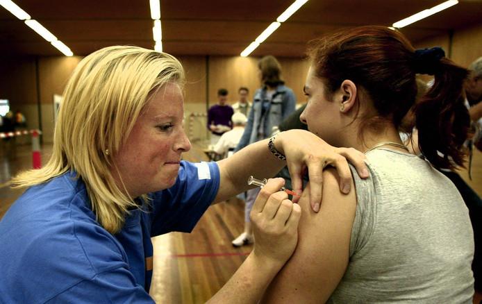 Foto ter illustratie. Kinderen worden ingeënt.