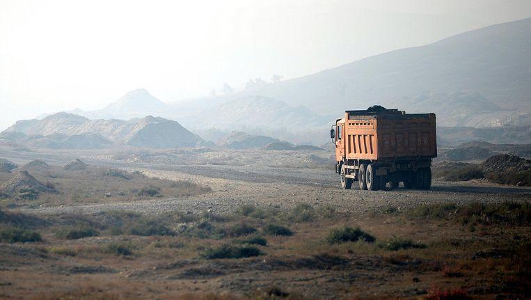 Een truck vervoert goederen in Urumqi in het westen van Xinjiang in 2014. Beeld AFP