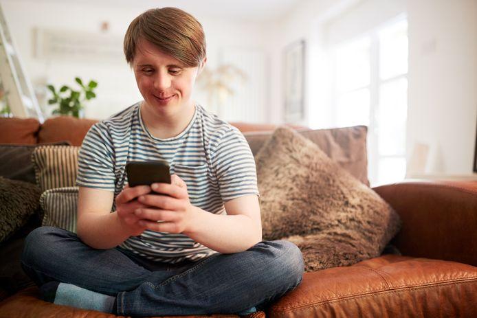 Een jongeman met het Syndroom van Down.