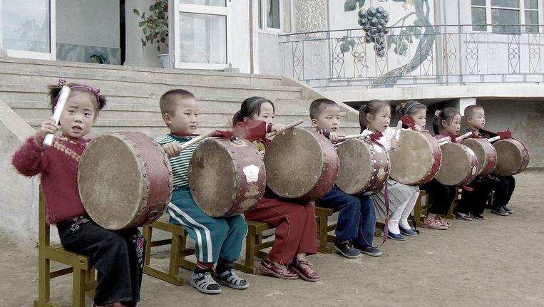 Noord-Koreaanse kinderen maken muziek in Wonsan, Noord Korea. Beeld Yeowatzup (Flickr)