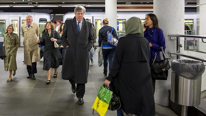 Minister van Veiligheid en Justitie Ivo Opstelten neemt de metro in Rotterdam.