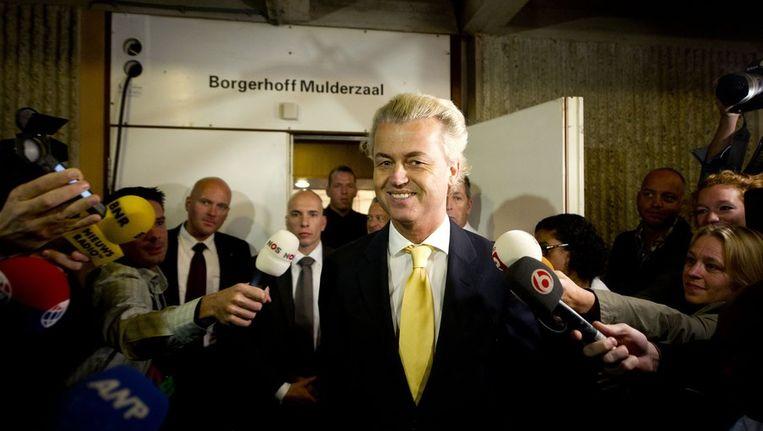 Geert Wilders reageert blij na de uitspraak. Beeld null