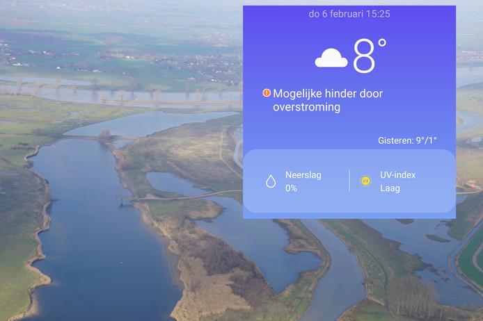 Het hoge water bij de Hemelrijkse Waard nabij Oijen, gefotografeerd vanuit het vliegtuig van waterschap Aa en Maas. Inzet: de waarschuwing in de weerapp van Android-telefoons.
