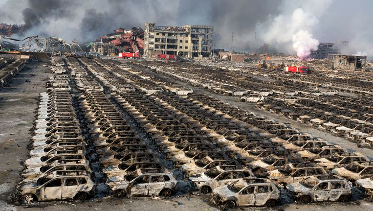 Uitgebrande auto's in Tianjin, China. Beeld AP