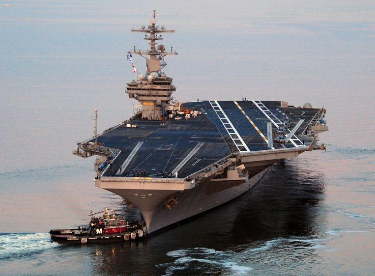 Het USS George H.W. Bush-vliegdekschip dat naar de Golf is gestuurd in reactie op de crisis in Irak. Beeld afp