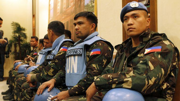 De Filipijnse vredesmilitairen werden gisteren vrijgelaten. Beeld ap