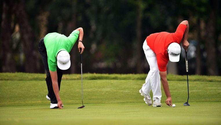Leden van de Communistische Partij mogen in China weer de golfbaan op. Beeld AFP