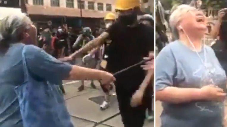 Oudere vrouw tijdens protestactie in Hong Kong