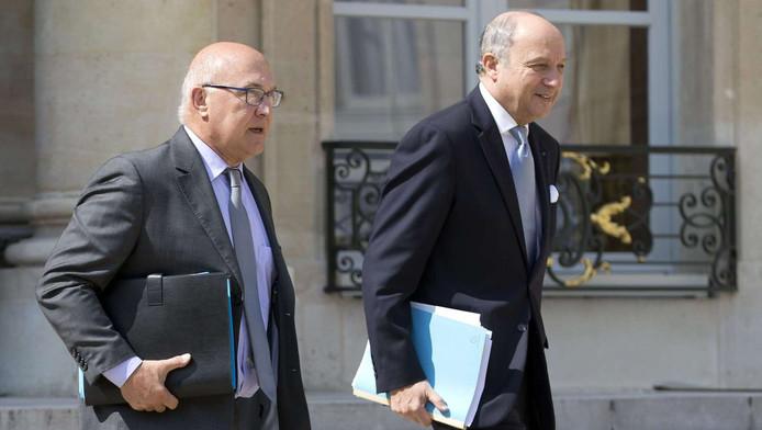 Michel Sapin et Laurent Fabius, ministre des Affaires étrangères