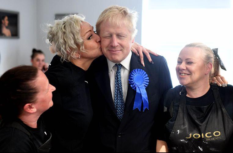 Boris Johnson roept op de Conservatieven niet af te straffen. Beeld Photo News
