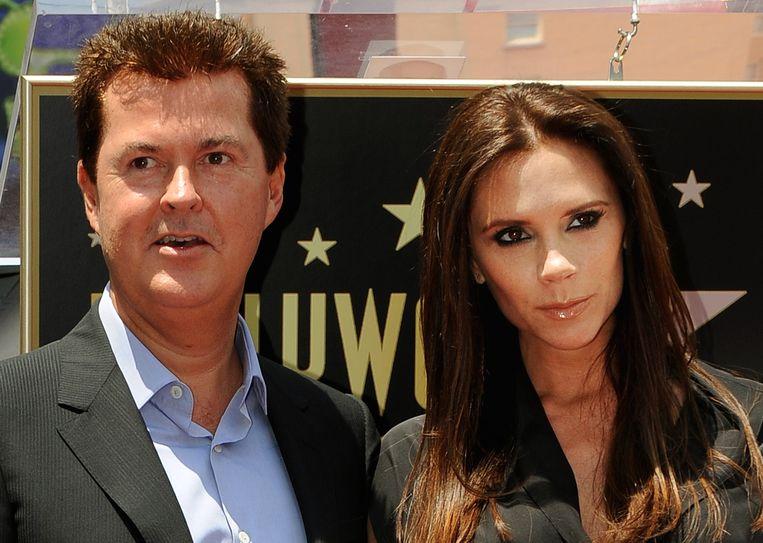 Manager Simon Fuller en Victoria Beckham enkele jaren terug.