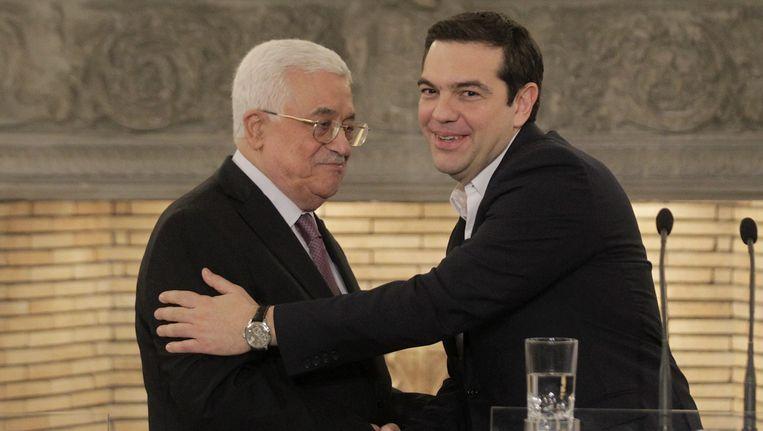 Griekse premier Alexis Tsipras en Palestijnse president Mahmoud Abbas op 21 december in Athene Beeld epa