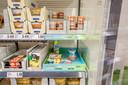 Klanten herkennen de goedkope producten aan de de lichtgroene uitstallingen.