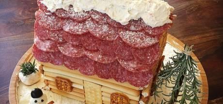 Dikke kersthit voor de borreltafel: een huisje van kaas, vleeswaren en noten
