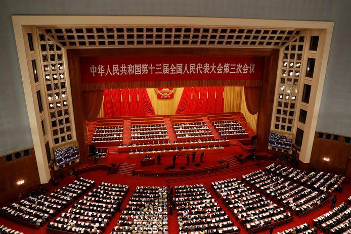 Autoriteiten en parlementariërs tijdens de opening van het Nationale Volkscongres in Beijing.