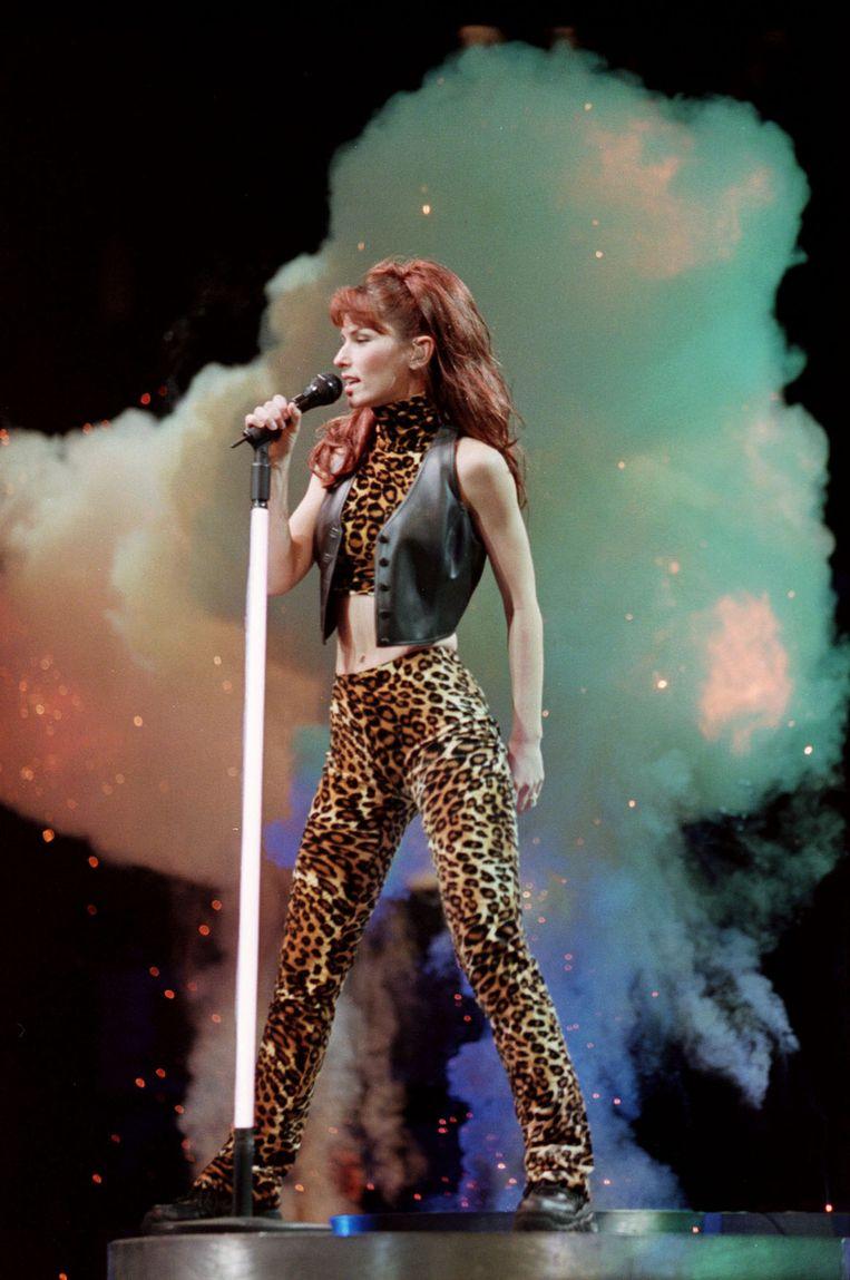 Shania Twain tijdens een optreden in Canada in 1999. Beeld Getty Images